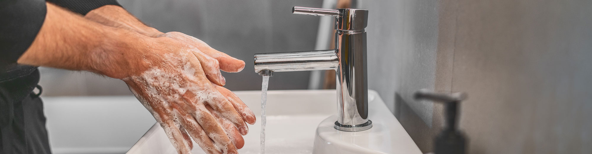 Coronavirus travel prevention wash hands with soap and hot water